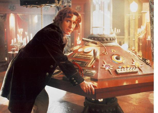 A publicity shot for the TV movie.  The Eighth Doctor (Paul McGann) at the TARDIS console.